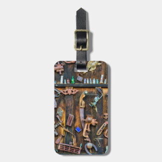 Antique collection on wall luggage tag