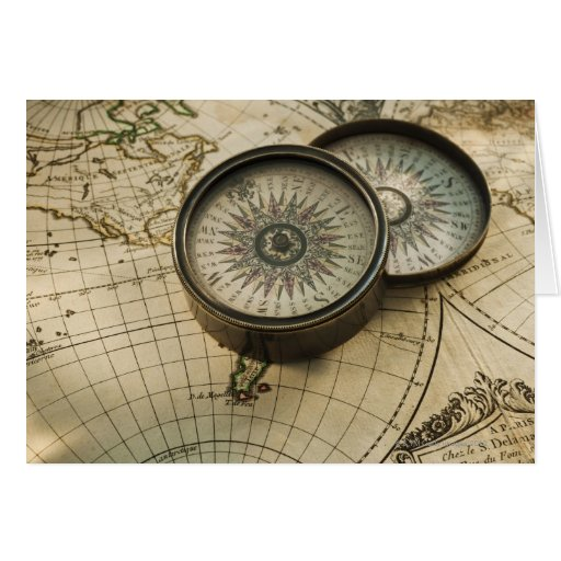 Antique compass on map card