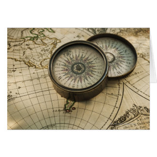 Antique compass on map greeting card