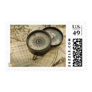Antique compass on map stamp