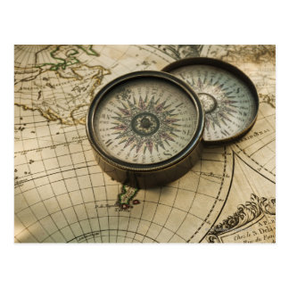 Antique compass on map postcard