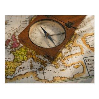 Antique compass on map postcards