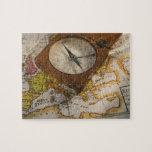 Antique compass on map puzzle
