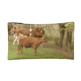 Antique cows in a field makeup bag