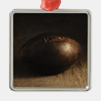 Antique football metal ornament