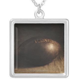Antique football square pendant necklace
