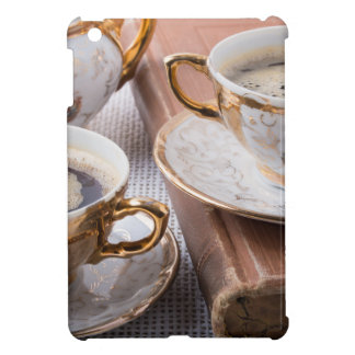 Antique porcelain coffee cups with hot espresso iPad mini cover