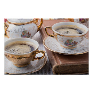 Antique porcelain coffee cups with hot espresso poster