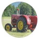 Antique Red and Yellow Tractor in Field Plates