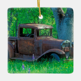 Antique rusted truck in a meadow ceramic ornament