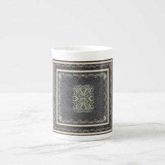 Antique Scroll Design on Worn Leather Tea Cup