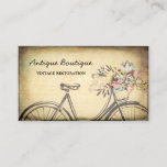 """Antique Shop Vintage Restoration Floral Bicycle Business Card<br><div class=""""desc"""">Let the community know that you can restore their heirlooms and collectibles with these stylish antique shop business cards featuring an old fashioned bicycle for women embellished with a basket of pretty flowers and an elegant vintage grunge background. Personalize by adding the name of the boutique and contact information.</div>"""