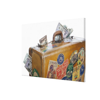 Antique suitcase with protruding money canvas prints