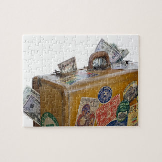 Antique suitcase with protruding money jigsaw puzzles
