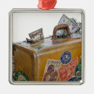 Antique suitcase with protruding money metal ornament