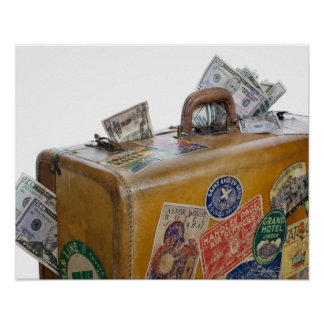 Antique suitcase with protruding money posters