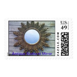 antique sunburst mirror ..reflects the blue sky postage