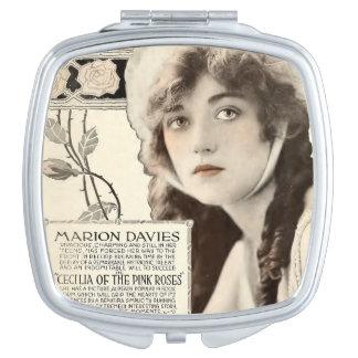 Anuncio 1918 del expositor de la película muda de espejos para el bolso