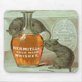 Anuncio del whisky de puré amargo de la ermita con tapete de raton