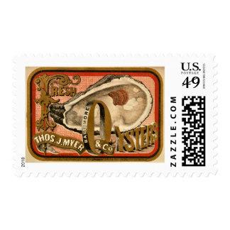 Anuncio fresco del vintage de las ostras circa sello