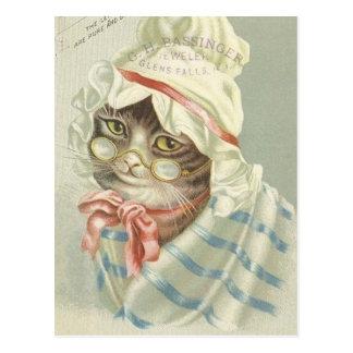 Anuncio óptico del vintage con el gato postal