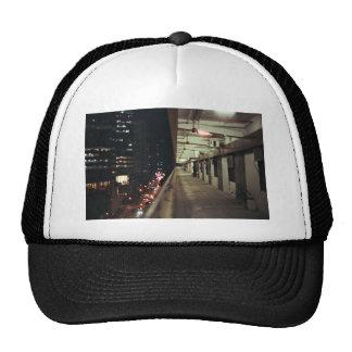 Apartment balcony, city lights at night trucker hat