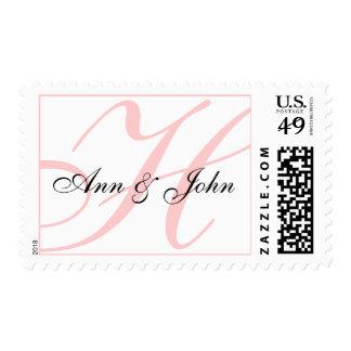 Apellido H inicial más el sello rosado blanco de