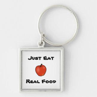 Apenas coma la comida real llaveros
