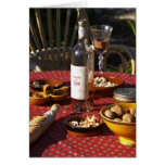 Aperitif and appetizers prepared: bread, olives, greeting card