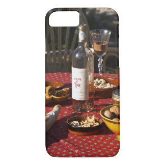 Aperitif and appetizers prepared: bread, olives, iPhone 8/7 case