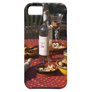 Aperitif and appetizers prepared: bread, olives, iPhone SE/5/5s case