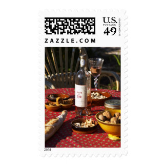 Aperitif and appetizers prepared: bread, olives, postage stamps
