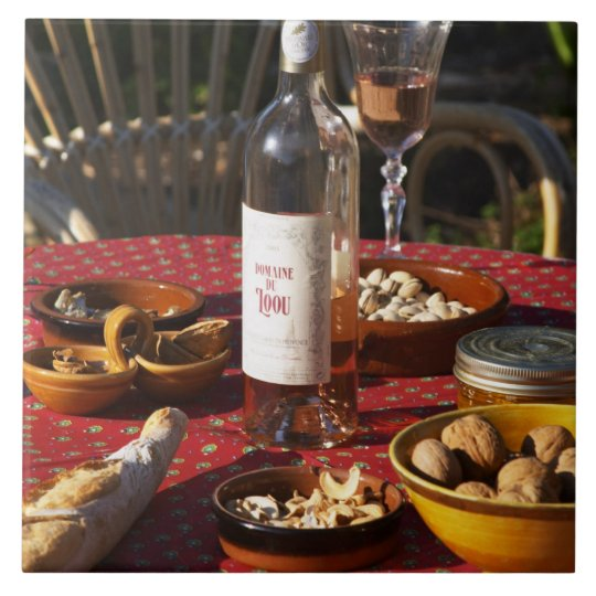 Aperitif and appetizers prepared: bread, olives, tile