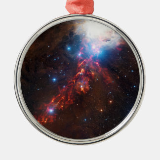 APEX View of a Star Formation in the Orion Nebula Ornament