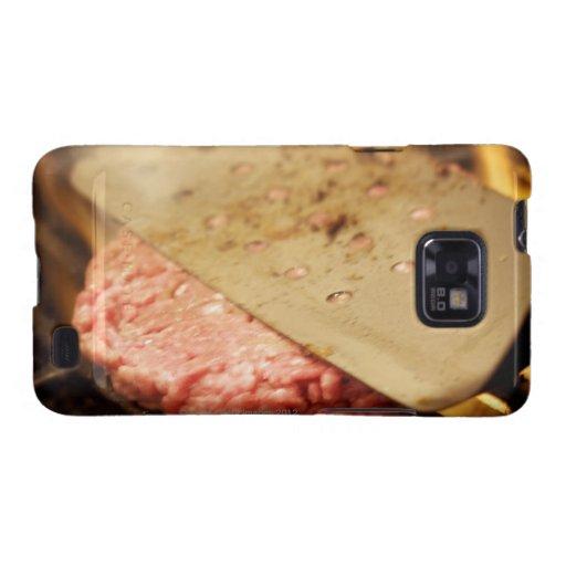 Aplanando una hamburguesa Patty con una espátula Carcasa Para Samsung Galaxy S2