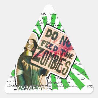 Apocalipsis del zombi - no alimente a los zombis pegatina triangular