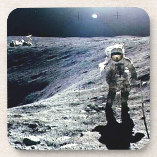 Apollo Astronaut walking on the Moon and crater Coaster