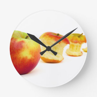 Apple and apple cores isolated on white round clock