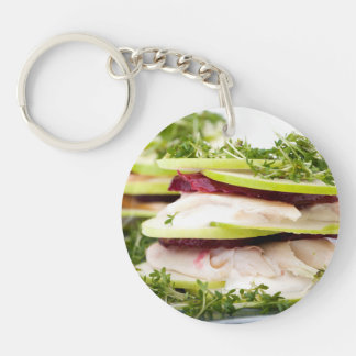 Apple and trout appetizer Double-Sided round acrylic keychain