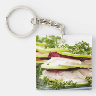 Apple and trout appetizer Double-Sided square acrylic keychain