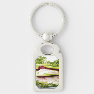 Apple and trout appetizer Silver-Colored rectangular metal keychain