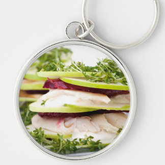 Apple and trout appetizer Silver-Colored round keychain