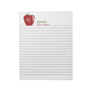 Apple brillante del profesor alineó la libreta bloc de papel