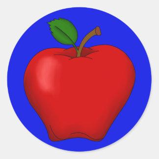 Apple con el pegatina redondo del fondo azul