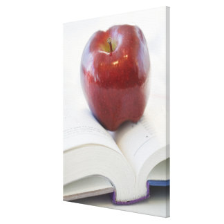 Apple on Open Text Book Canvas Print