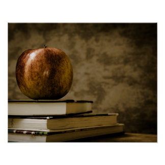 Apple on Top of a Stack of Books on a Desk Poster