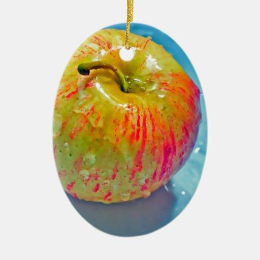 Apple que brilla intensamente adorno navideño ovalado de cerámica