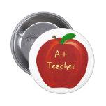 Apple rojo, A+ Perno del profesor en los botones Pin