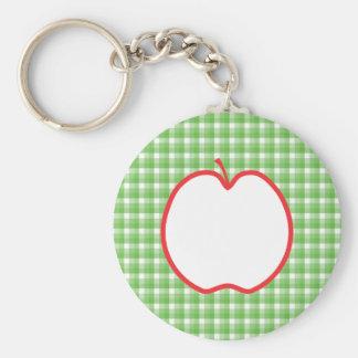 Apple rojo. Con el fondo verde y blanco del contro Llavero Redondo Tipo Pin