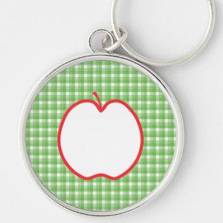 Apple rojo. Con el fondo verde y blanco del contro Llavero Redondo Plateado